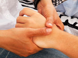 soft tissue massage therapy hands